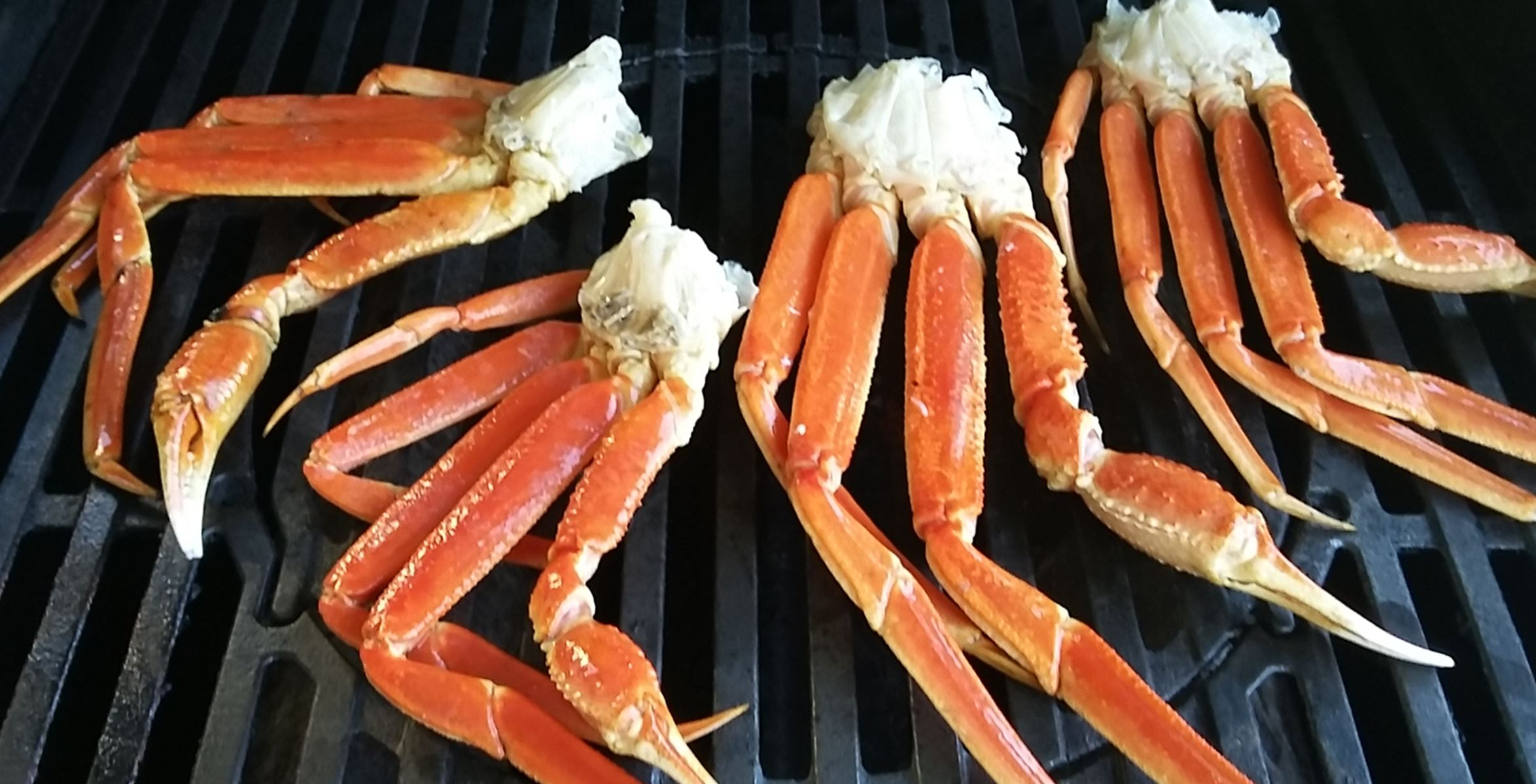 crab leg clusters on gas grill